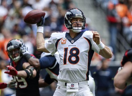 Dec 22, 2013; Houston, TX, USA; Denver Broncos quarterback Peyton Manning (18) attempts a pass during the second quarter against the Houston