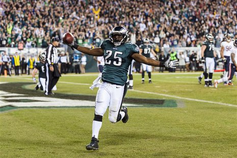 Dec 22, 2013; Philadelphia, PA, USA; Philadelphia Eagles running back LeSean McCoy (25) celebrates scoring a touchdown during the third quar