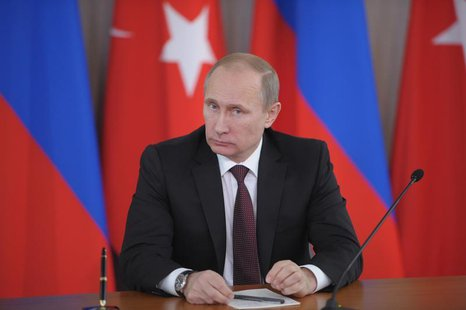 Russia's President Vladimir Putin attends a news conference with Turkey's Prime Minister Tayyip Erdogan (not seen) in Strelna near St. Peter
