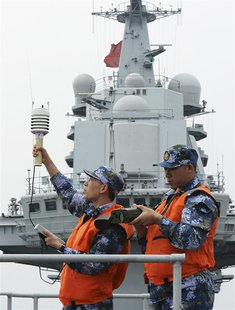 "Chinese naval soldiers monitor meteorological indicators on the aircraft carrier ""Liaoning"", as they carry out training in South China Sea,"