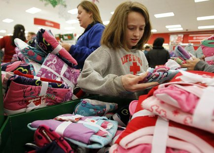 "Shoppers look through a bin full of pajamas inside a Target store on the shopping day dubbed ""Black Friday"" in Torrington, Connecticut Novem"