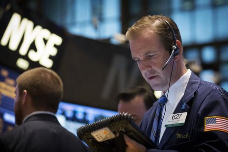 Traders work on the floor of the New York Stock Exchange (NYSE) October 23, 2013. REUTERS/Brendan McDermid