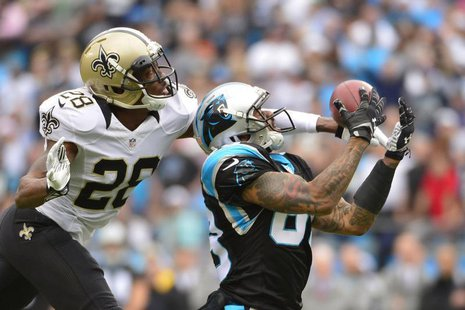 Dec 22, 2013; Charlotte, NC, USA; Carolina Panthers wide receiver Steve Smith (89) catches the ball as New Orleans Saints cornerback Keenan