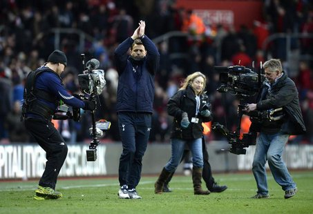 Tottenham Hotspur caretaker manager Tim Sherwood gestures to fans after winning their English Premier League soccer match against Southampto