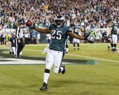 Dec 22, 2013; Philadelphia, PA, USA; Philadelphia Eagles running back LeSean McCoy (25) celebrates scoring a touchdown during the third quarter against the Chicago Bears at Lincoln Financial Field. Mandatory Credit: Howard Smith-USA TODAY Sports