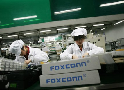 Employees work inside a Foxconn factory in the township of Longhua in the southern Guangdong province in this May 26, 2010 file photo. REUTE