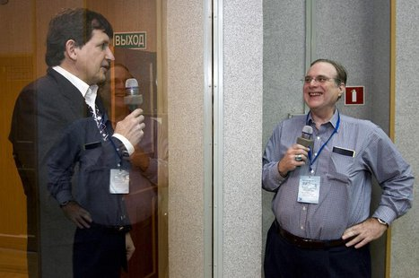 U.S. entrepreneur Charles Simonyi (L) meets his friend, Microsoft co-founder Paul Allen at the Baikonur cosmodrome March 25, 2009. REUTERS/S