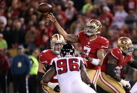 Dec 23, 2013; San Francisco, CA, USA; San Francisco 49ers quarterback Colin Kaepernick (7) passes the ball with pressure from Atlanta Falcon