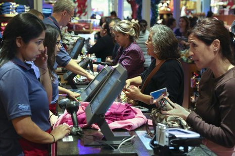 Black Friday customers make purchases at a Disney store at the Glendale Galleria in Glendale, California November 29, 2013. REUTERS/Jonathan