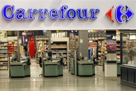 The logo of Carrefour is seen at the entrance of the Carrefour's Bercy hypermarket in Charenton Le Pont, near Paris, August 29, 2013. REUTER