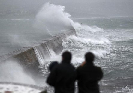 Waves crash over the breakwater of Saint Evette harbour at Esquibien in Brittany as an Atlantic storm hits western France, December 23, 2013