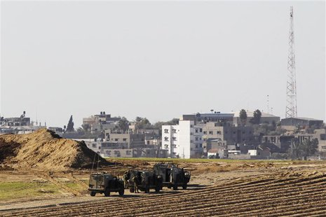 Israeli military jeeps are seen at the scene of a shooting incident near the border with the northern Gaza Strip, near kibbutz Nahal Oz Dece