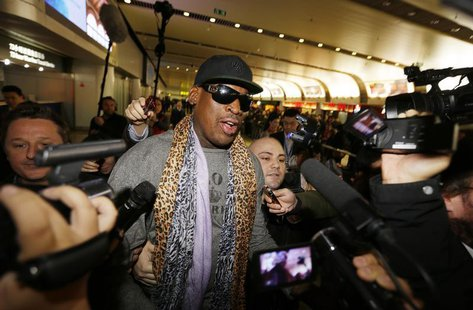 Former NBA basketball player Dennis Rodman speaks to the media after returning from his trip to North Korea at Beijing airport, December 23,