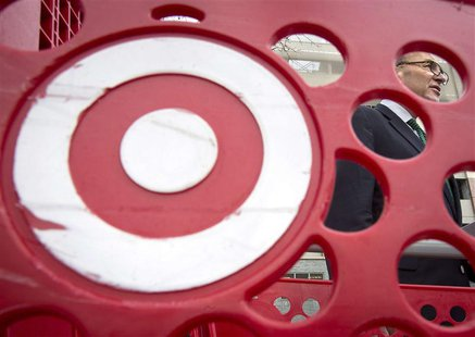 U.S. Senator Charles Schumer, is pictured through a Target shopping cart, as he holds a news conference about the massive credit card hack t