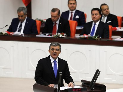Turkey's President Abdullah Gul addresses the Turkish Parliament during a debate marking the reconvene of the parliament after a summer rece