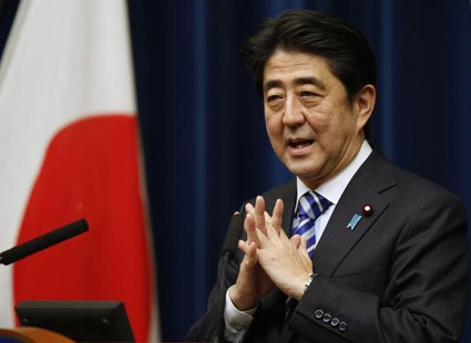 Japan's Prime Minister Shinzo Abe speaks during a news conference to wrap up the ASEAN-Japan Commemorative Summit Meeting at his official re
