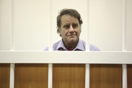 Peter Willcox, captain of the Greenpeace ship Arctic Sunrise, sits in the defendants' cage during a court hearing in St. Petersburg November