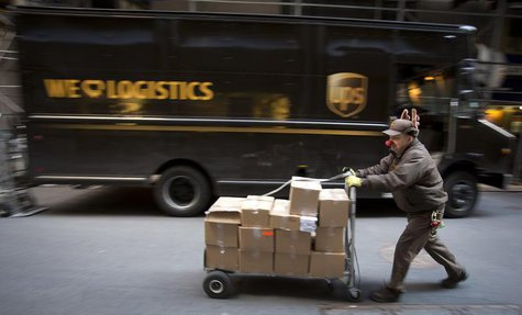 UPS delivery man Vinny Ambrosino prepares to deliver packages on Christmas Eve while wearing a Rudolf nose and antlers in New York, December
