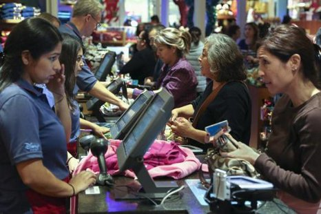 Black Friday customers make purchases at a Disney store at the Glendale Galleria in Glendale, California November 29, 2013.  Credit: Reuters/Jonathan Alcorn