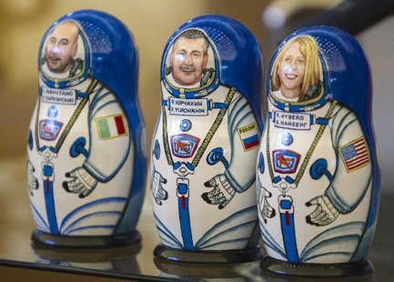 Matryoshka dolls, or Russian nesting dolls, depicting the International Space Station (ISS) crew members (L to R) Italian astronaut Luca Par