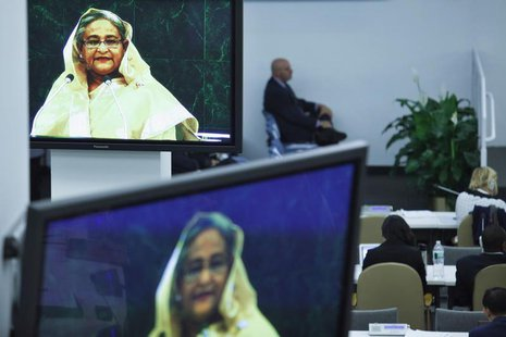 Delegates listen to Bangladesh's Prime Minister Sheikh Hasina (pictured on screens) while she addresses the 68th United Nations General Asse