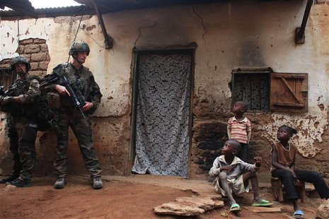 French soldiers conduct a daytime patrol in a neighbourhood in Bangui, where shooting continued overnight in the capital, December 26, 2013.