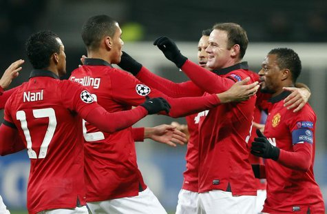 Manchester United's Nani, Chris Smalling, Ryan Giggs, Wayne Rooney and Patrice Evra (L-R) celebrate after Bayer Leverkusen's Emir Spahic sco