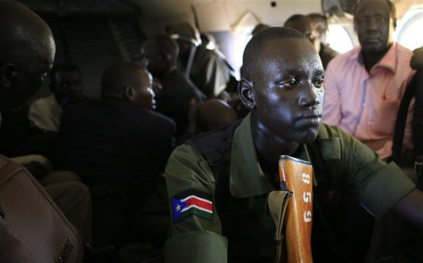 A South Sudan army soldier sweats as he holds his weapon during a flight from the capital Juba to Bor town, 180 km (108 miles) northwest fro