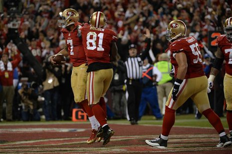San Francisco, CA, USA; San Francisco 49ers quarterback Colin Kaepernick (7) celebrates after scoring a touchdown against the Atlanta Falcon