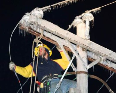 A utility worker works on frozen power lines (photo courtesy Consumers Energy)