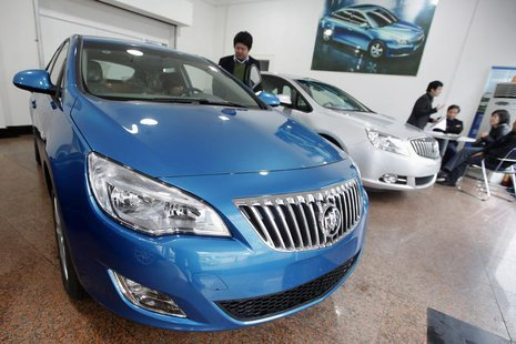 A customer looks at a Buick car at a General Motors auto dealership in Shanghai December 13, 2010. REUTERS/Aly Song