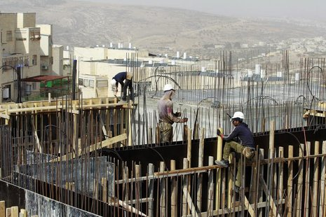 Palestinian labourers work on a construction site in Ramat Shlomo, a religious Jewish settlement in an area of the occupied West Bank Israel