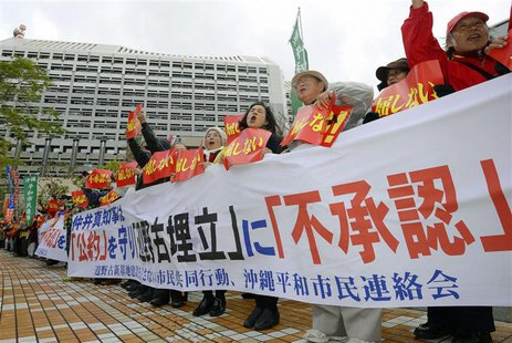 Protesters shout slogans during a rally against the relocation of a U.S. military base, in front of the Okinawa prefectural government offic