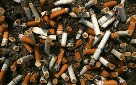 Cigarette butts fill an ashtray outside a construction site in Central, a business district in Hong Kong, October 18, 2006. REUTERS/Paul Yeu