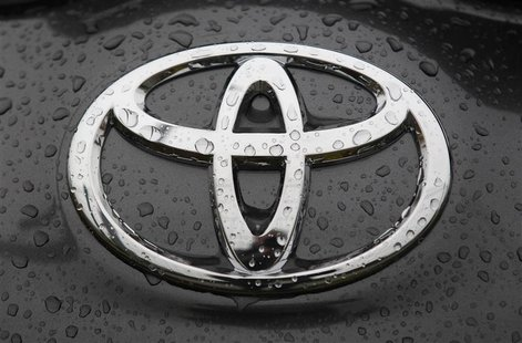 The Toyota logo is seen on a car at a Japan's Toyota Motor Corp car dealership in Hoenheim near Strasbourg, eastern France October 10, 2012.