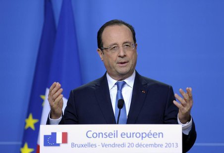 France's President Francois Hollande addresses a news conference during a European Union leaders summit in Brussels December 20, 2013. REUTE