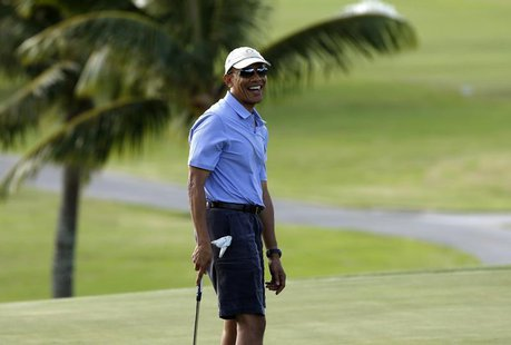 U.S. President Barack Obama smiles as he plays on the 18th hole during a round of golf at Mid Pacific Country Club in Kailua, Hawaii Decembe