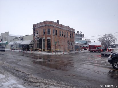 Investigators look to find out the cause behind an early morning fire at a downtown Oconto bar Wednesday, Dec. 25, 2013. (Photo from: FOX 11).
