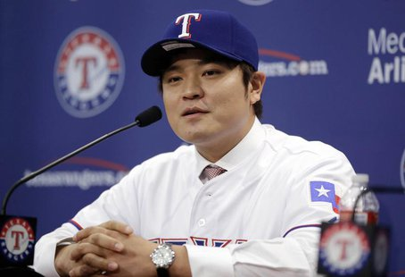 Texas Rangers outfielder Shin-Soo Choo talks to the media after being introduced at a press conference at Texas Rangers Ballpark. Mandatory