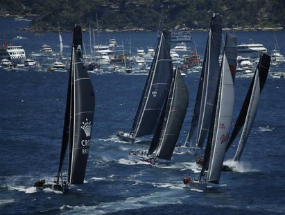 The field of yachts led by Wild Oats XI (2nd R) and Perpetual Loyal (L) sail out of Sydney Harbour at the start of the annual Sydney to Hoba