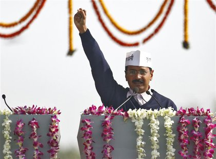 Arvind Kejriwal, leader of Aam Aadmi (Common Man) Party (AAP), shouts slogans after taking the oath as the new chief minister of Delhi durin