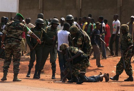 Personnel from the African Union peacekeeping mission to Central African Republic (MISCA) control a fighting crowd near the airport, in the