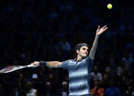 Roger Federer of Switzerland serves to Rafael Nadal of Spain during their men's singles semi-final tennis match at the ATP World Tour Finals