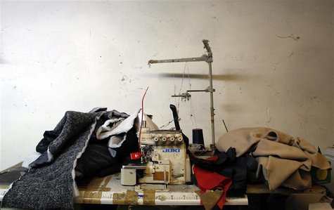 An industrial sewing machine is pictured as police officers conduct a check at the Shen Wu textile factory in Prato December 9, 2013. REUTER
