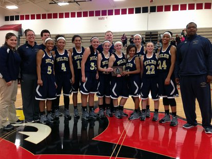 Niles won the varsity girls division of the 5th Annual Cardinal Holiday Hoops Tournament.
