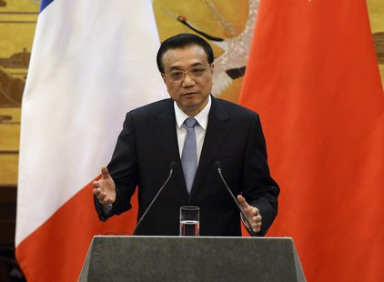 Chinese Premier Li Keqiang gives an address during a news conference with French Prime Minister Jean-Marc Ayrault (not pictured) in the Grea