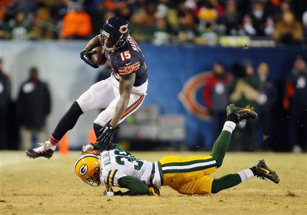 Dec 29, 2013; Chicago, IL, USA; Chicago Bears wide receiver Brandon Marshall (15) is tackled by Green Bay Packers cornerback Tramon Williams
