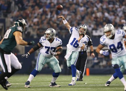 Dec 29, 2013; Arlington, TX, USA; Dallas Cowboys quarterback Kyle Orton (18) throws in the pocket against the Philadelphia Eagles at AT&T St