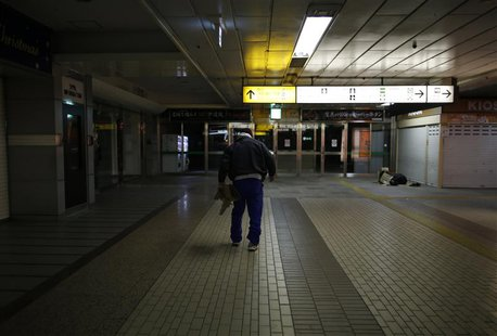 Shizuya Nishiyama, a 57-year-old homeless man from Hokkaido, walks at Sendai Station in Sendai, northern Japan December 18, 2013. REUTERS/Is