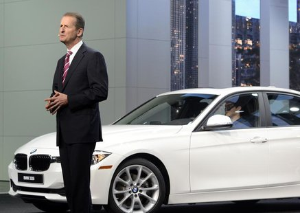 Dr. Herbert Diess, of the BMW Board of Management, speaks next to a 320i model at the North American International Auto Show in Detroit, Mic